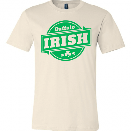 A beige T-shirt with green Buffalo Irish graphic.