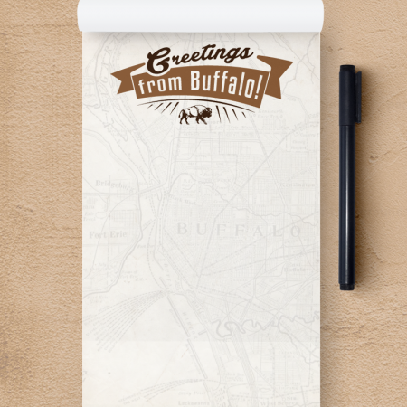 A customized notepad reading Greetings from Buffalo at the top, with the map of the area faded to the background.