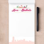 A customized notepad reading Love Buffalo at the top, which the skyline and the bottom.